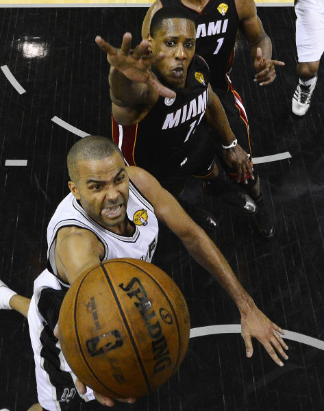 San Antonio Spurs' Tony Parker shoots as Miami Heat's Mario Chalmers defends during the second half at Game 5 of the NBA Finals basketball series, Sunday, June 16, 2013, in San Antonio. The Spurs won 114-104. (AP Photo/John G. Mabanglo)