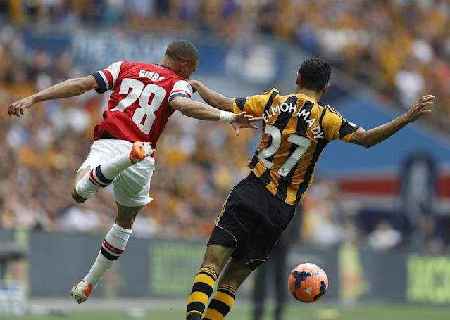Arsenal's Kieran Gibbs, left, challenges Hull City's Ahmed El mohamady during the English FA Cup final soccer match between Arsenal and Hull City at Wembley Stadium in London, Saturday, May 17, 2014. (AP Photo/Kirsty Wigglesworth)
