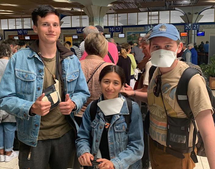 Image: From left, Alex Walsh, Genevieve Serna and Jacob Muscarella at Agadir airport in Morocco on Wednesday hoping to board a flight back to the U.S. (Genevieve Serna)