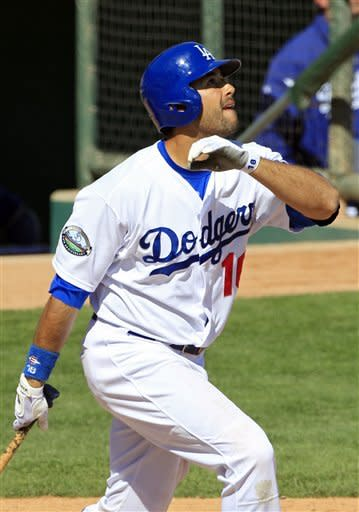 Los Angeles Dodgers' Andre Ethier watches his two-run home run off Milwaukee Brewers relief pitcher Marco Estrada in the fifth inning of a spring training baseball game Tuesday, March 20, 2012, in Glendale, Ariz. (AP Photo/Mark Duncan)