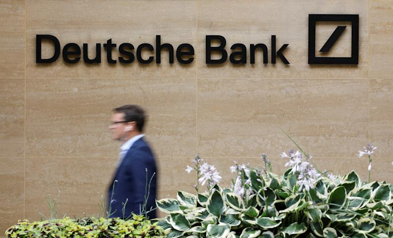 A pedestrian walks past a logo outside the offices of German bank Deutsche Bank in central London on July 8, 2019. - Germany's biggest lender Deutsche Bank said Sunday it would cut 18,000 jobs by 2022, as the former leading light of the country's financial sector looks to escape years of turmoil. With almost 8,000 staff, Deutsche Bank is one of the biggest employers in the City of London. (Photo by Tolga AKMEN / AFP) (Photo credit should read TOLGA AKMEN/AFP/Getty Images)