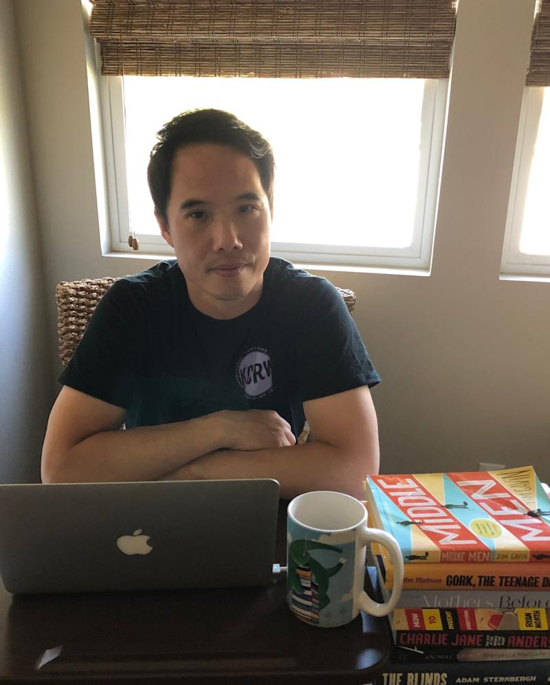 Charles Yu in quarantine, with the books inspiring his writing.