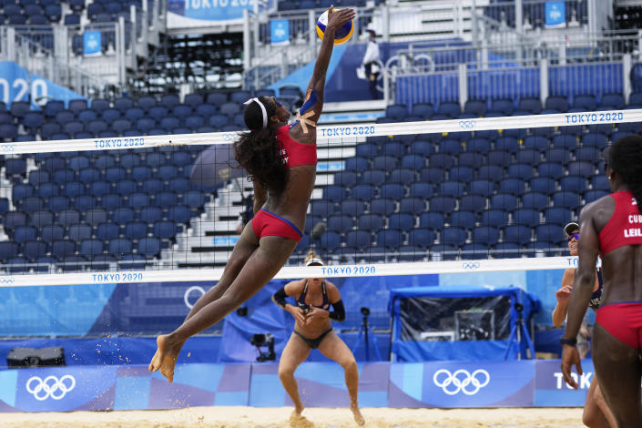 Lidianny Echevarria Benitez, of Cuba, jumps high for the ball during a women's beach volleyball match against the United States at the 2020 Summer Olympics, Monday, Aug. 2, 2021, in Tokyo, Japan. (AP Photo/Petros Giannakouris)