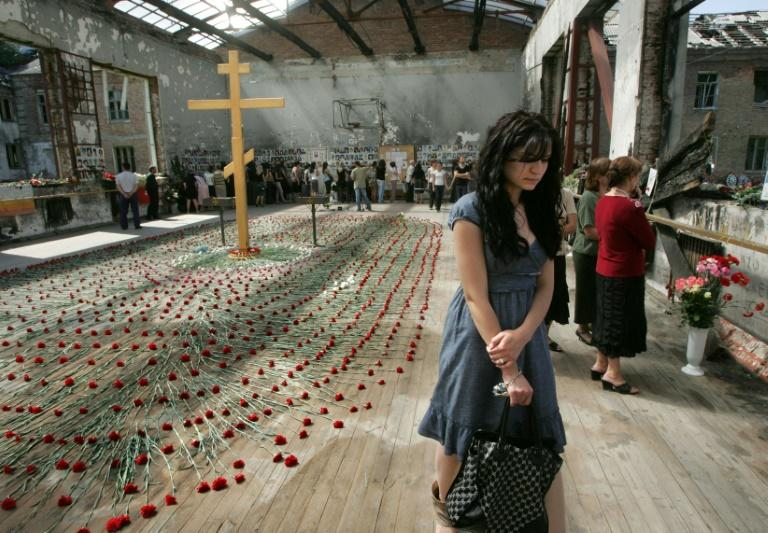 Mourners gather inside the Beslan school gymnasium at the school in North Ossetia on September 1, 2009 as they commemorate the fifth anniversary of the 2004 terrorist massacre