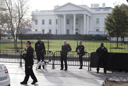 FILE PHOTO: Secret Service agents patroling in front of the White House