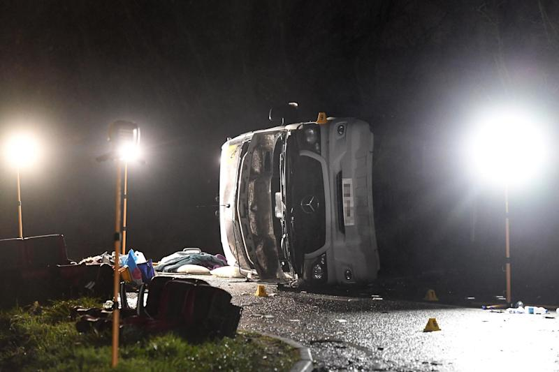 A minibus seen on its side after the serious crash near the village of Bluntisham in Cambridgeshire: PA
