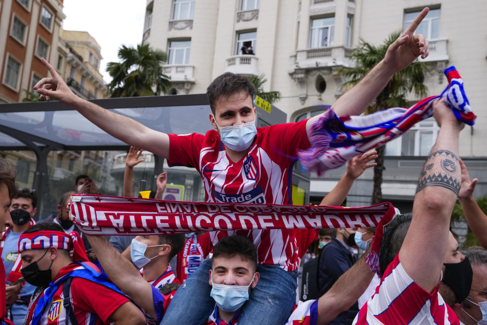 Atletico Madrid supporters celebrate their team's Spanish La Liga title in Madrid, Saturday, May 22, 2021. Atletico clinches its 11th Spanish La Liga title. (AP Photo/Paul White)