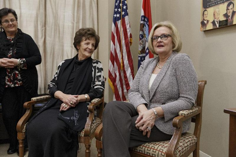 Philomena Lee, center, an Irish woman whose search for the son that she gave up for adoption in the 1950's, and is now a Hollywood film, meets with Sen. Claire McCaskill, D-Mo., right, on Capitol Hill in Washington, Thursday, Jan. 30, 2014. With her life story now the subject of an Oscar-nominated film, Philomena Lee is calling for government reforms in Ireland that would grant adopted people access to their adoption files. At far left is Mari Steed, with the Adoption Rights Alliance. (AP Photo)