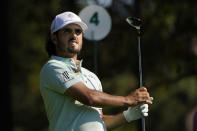 Abraham Ancer, of Mexico, watches his tee shot on the fourth hole during the second round of the Masters golf tournament Friday, Nov. 13, 2020, in Augusta, Ga. (AP Photo/Chris Carlson)