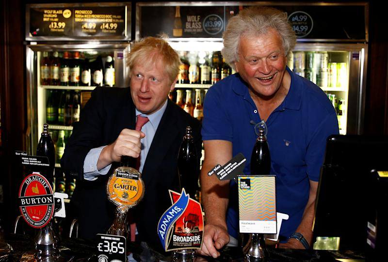 Boris Johnson, a leadership candidate for Britain's Conservative Party, and JD Wetherspoon chairman Tim Martin draft a beer together at Wetherspoons Metropolitan Bar in London, Britain, July 10, 2019. REUTERS/Henry Nicholls/pool