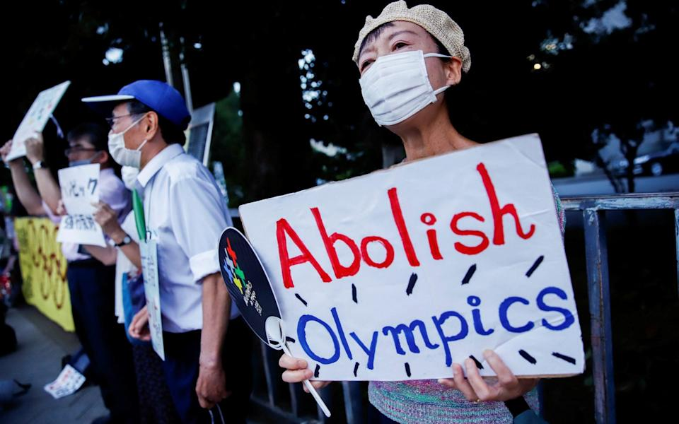 Anti-Olympics protestors gather in front of the Japanese prime minister's office amid news of Tokyo's record high Covid-19 cases on 29 July 2021 - Androniki Christodoulou/Reuters