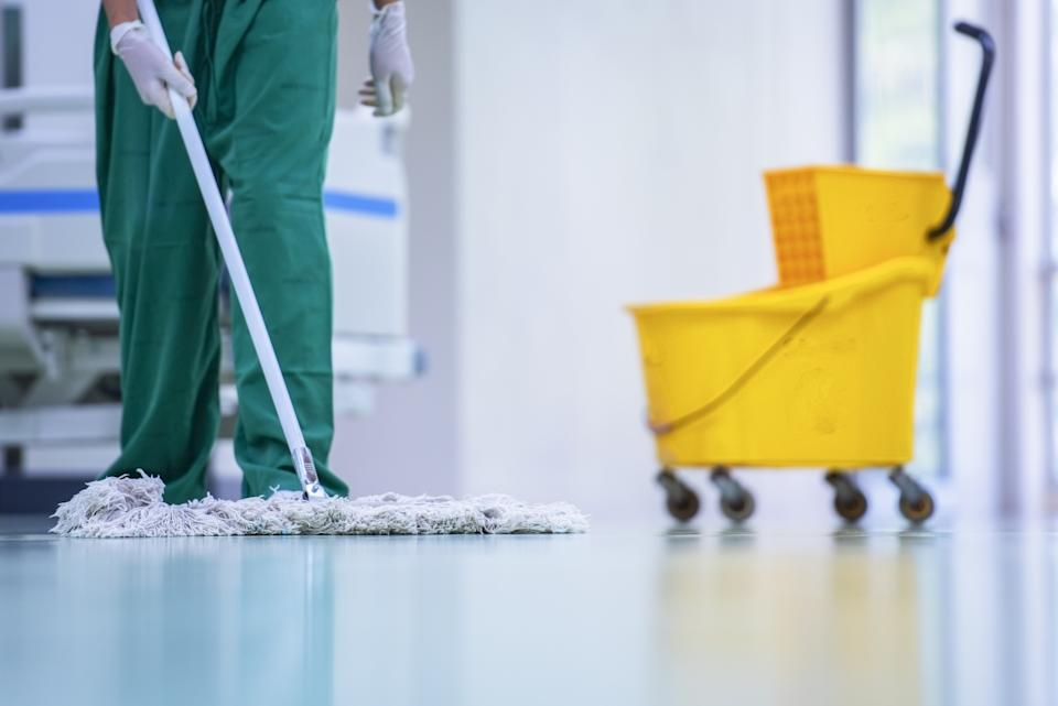 Clean and sanitize, Cleaner, Hospital cleaning,Cleaning the hospital floor. Floor care and cleaning services with washing mop in sterile factory or clean hospital.