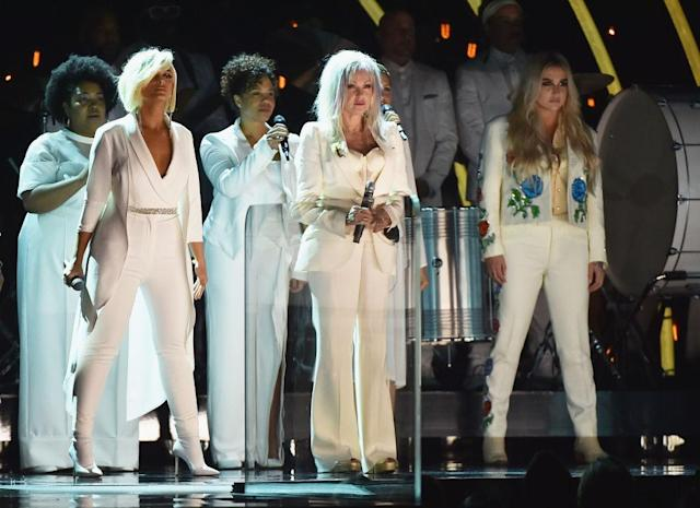 <p>Bebe Rexha (second from left), Cyndi Lauper (center), and Kesha (right) perform onstage during the 60th Annual Grammy Awards at Madison Square Garden on January 28, 2018, in New York City. (Photo: Getty Images) </p>