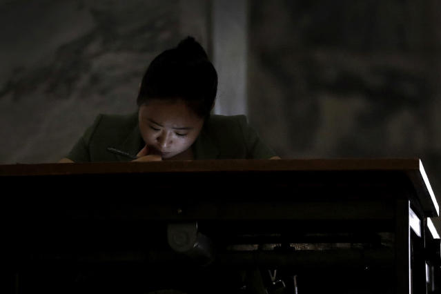 <p>A woman's face is illuminated by her phone as she reads at the Grand People's Study House on July 24, 2017, in Pyongyang, North Korea. The building is situated on Kim Il Sung Square and serves as the central library where North Koreans also go to for language classes such as English, Chinese German and Japanese. (Photo: Wong Maye-E/AP) </p>