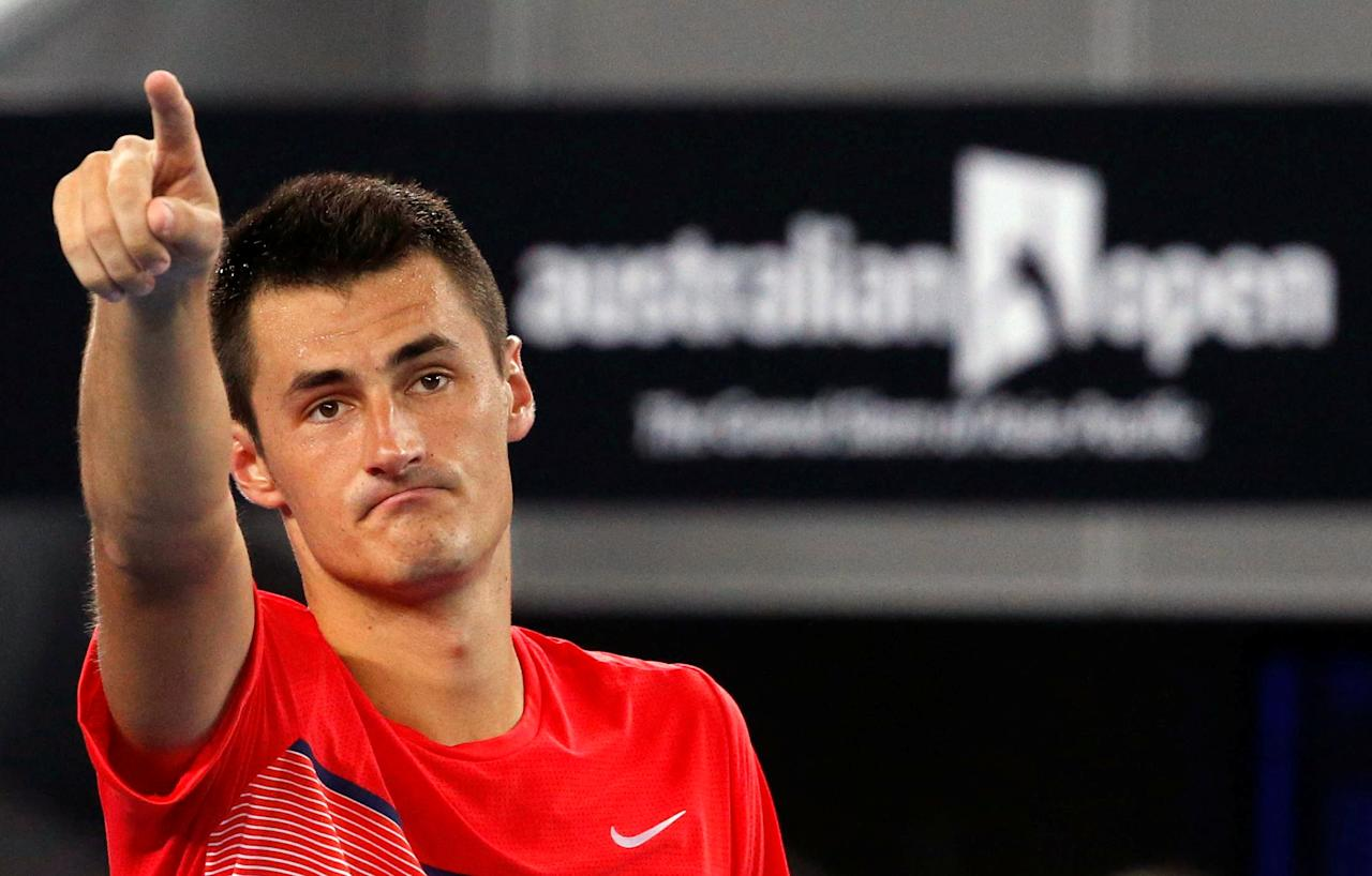 FILE PHOTO - Australia's Bernard Tomic celebrates after winning his second round match against Italy's Simone Bolelli at the Australian Open tennis tournament at Melbourne Park, Australia, January 21, 2016. REUTERS/Jason Reed/File Photo