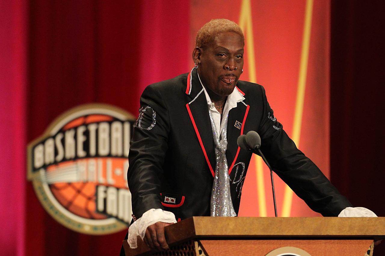 The former NBCA player Dennis Rodman faces up to 20 days in jail for failure to pay spousal and child support. The court filing alleges that he owed $808,935 in back child support. The former Chicago Bulls power forward is just the latest in a long string of pro athletes who have squandered their fortunes. Photo: Dennis Rodman speaks at the Basketball Hall of Fame Enshrinement Ceremony on Aug.12, 2011 in Springfield, Massachusetts.