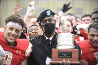 VMI Superintendent Maj. Gen. Cedric T. Wins holds the Silver Shako Trophy after they defeated The Citadel in an NCAA college football game, Saturday, April 17, 2021, in Lexington, Va. (David Hungate/Roanoke Times via AP)