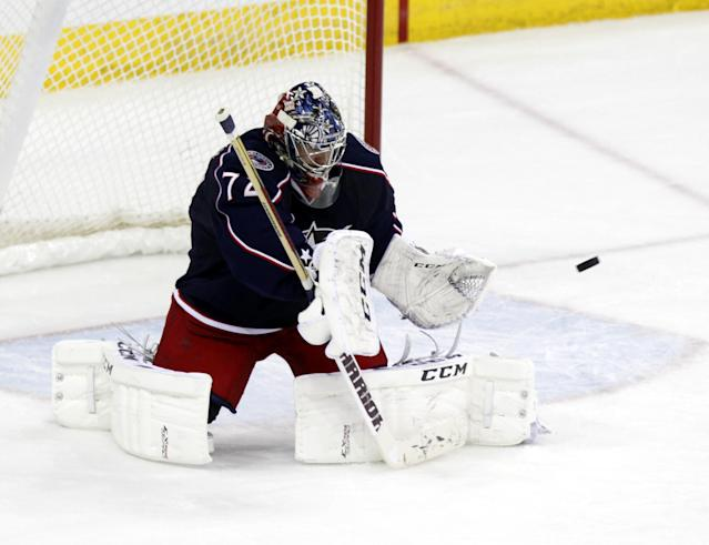 Columbus Blue Jackets goalie Sergi Bobrovsky, of Russia, stops a shot against the New York Islanders in the third period of an NHL hockey game in Columbus, Ohio, Sunday, April 6, 2014. The Blue Jackets won 4-0. (AP Photo/Paul Vernon)