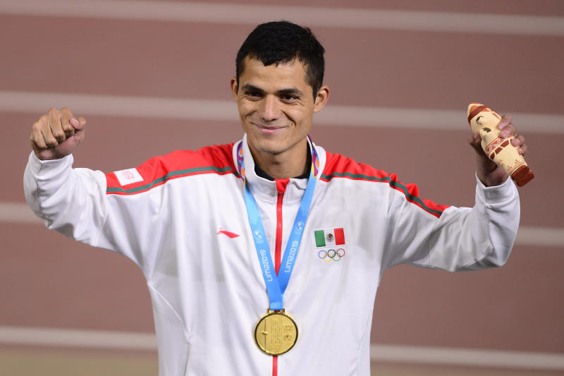 LIMA, PERU - AUGUST 06: Fernando Martinez of Mexico celebrates after winning gold medal during Athletics Men's 5000m Final on Day 11 of Lima 2019 Pan American Games at Athletics Stadium of Villa Deportiva Nacional on August 6, 2019 in Lima, Peru. (Photo by Gustavo Garello/Jam Media/Getty Images)