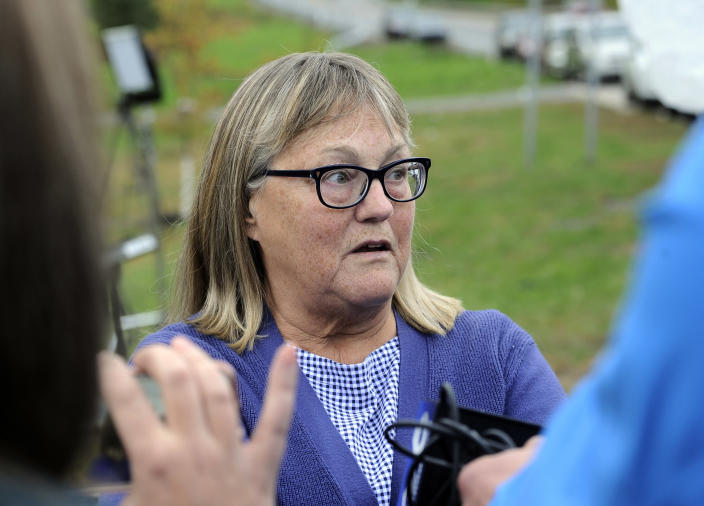 Barbara Douglas, of Danamora, N.Y., talks to reporters about her four family members who died in Saturday's fatal limousine crash in Schoharie, N.Y., Sunday, Oct. 7, 2018. A limousine loaded with revelers headed to a 30th birthday party blew a stop sign at the end of a highway and slammed into an SUV parked outside a store, killing all people in the limo and a few pedestrians, officials and relatives of the victims said Sunday. (AP Photo/Hans Pennink)