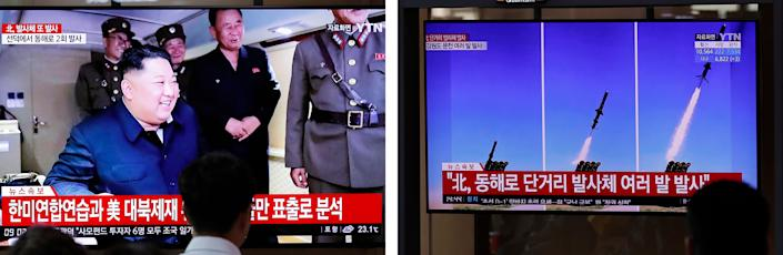 People watch a TV news program in Seoul, South Korea, reporting North Korea's firing of projectiles last August with a file image of North Korean leader Kim Jong Un.