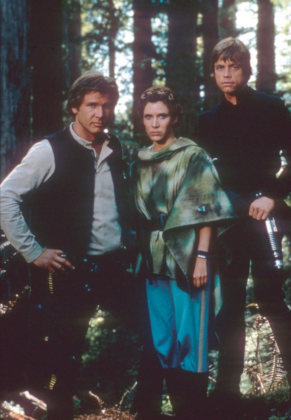 Harrison Ford as Han Solo, Carrie Fisher as Princess Leia, and Mark Hamill as Luke Skywalker in a promotional shot for <em>Return of the Jedi.</em> (Photo: Mary Evans/Lucasfilm/Ronald Grant/Everett Collection)