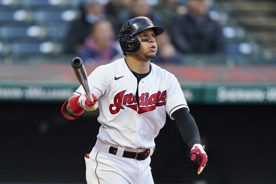 Cleveland Indians' Cesar Hernandez watches his ball after hitting a two-run home run in the fifth inning of a baseball game against the Chicago Cubs, Tuesday, May 11, 2021, in Cleveland. (AP Photo/Tony Dejak)