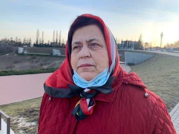 Natalia Yefimushkina looks out on Zmievskaya Balka, or the Ravine of Snakes, in Rostov-on-Don, Russia, where her grandparents were among the 27,000 predominantly Jewish people killed by the Nazis in 1942.  (Corinne Seminoff/CBC News - image credit)