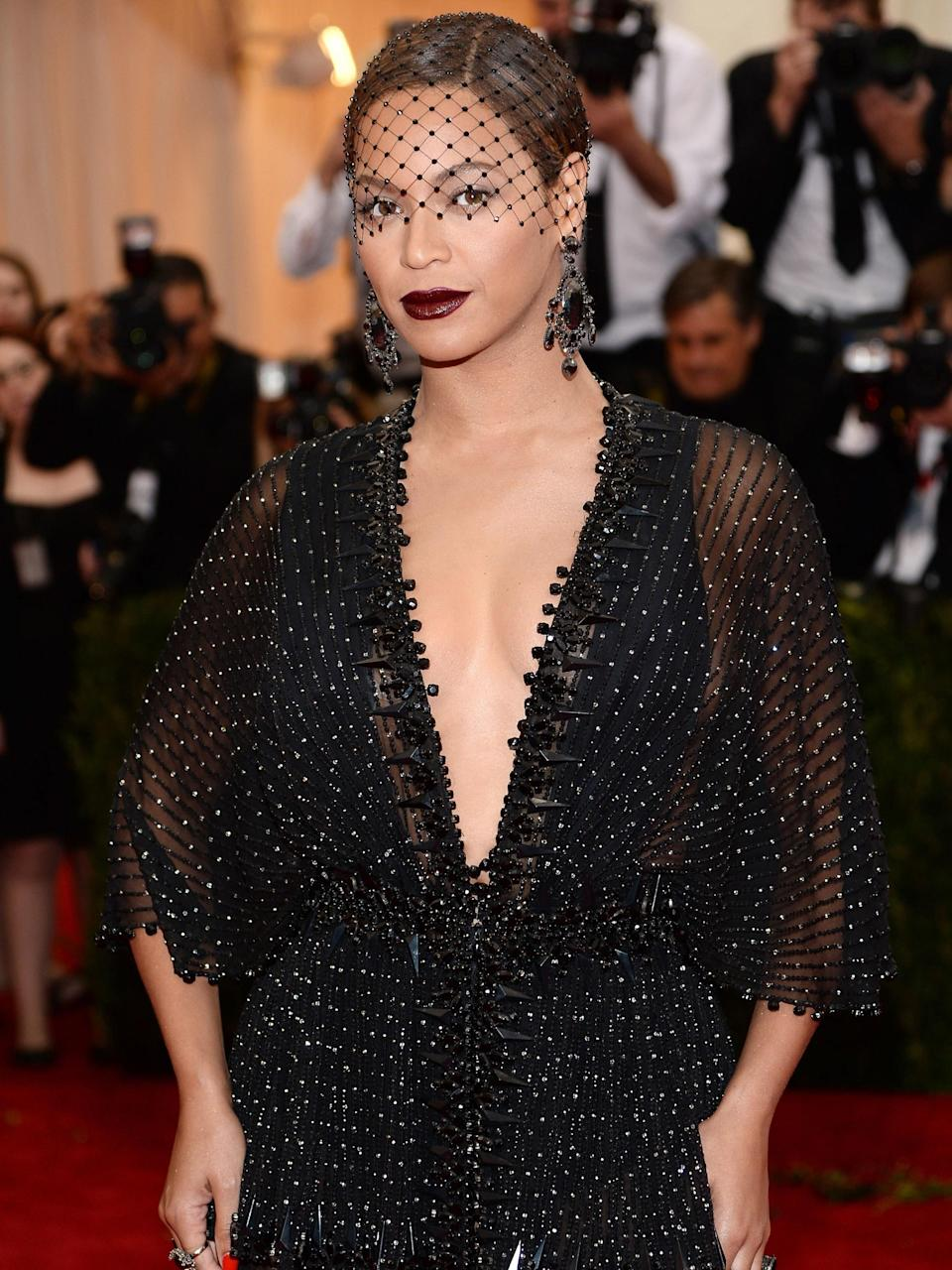 From Beyoncé's deep rouge-noir lip to Kate Moss' finger-raked waves, the Met Gala has long been the site of iconic beauty transformations.