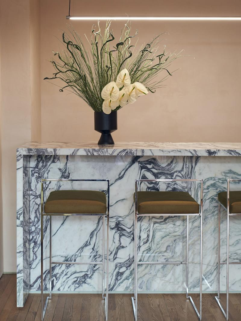 Styling math: Marble + Anthuriums = Chic.
