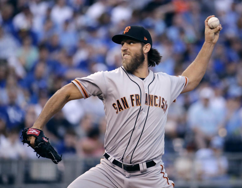 San Francisco Giants starting pitcher Madison Bumgarner throws during the first inning of a baseball game against the Kansas City Royals on Wednesday, April 19, 2017, in Kansas City, Mo. (AP Photo/Charlie Riedel)