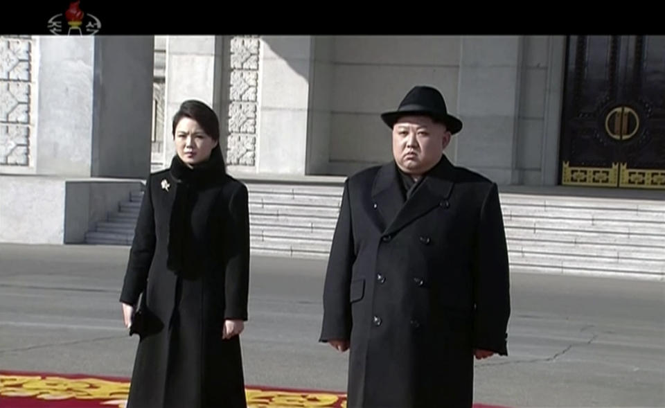 In this image made from video released by KRT on Feb. 8, 2018, North Korean leader Kim Jong Un, right, and his wife Ri Sol Ju arrive at a military parade in Pyongyang, Thursday, Feb. 8 2018. (KRT via AP)