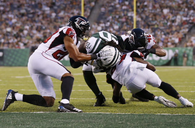 New York Jets running back Isaiah Crowell (20) breaks a tackle by Atlanta Falcons' Isaiah Oliver (20) to score a touchdown during the first half of a preseason NFL football game Friday, Aug. 10, 2018, in East Rutherford, N.J. (AP Photo/Adam Hunger)