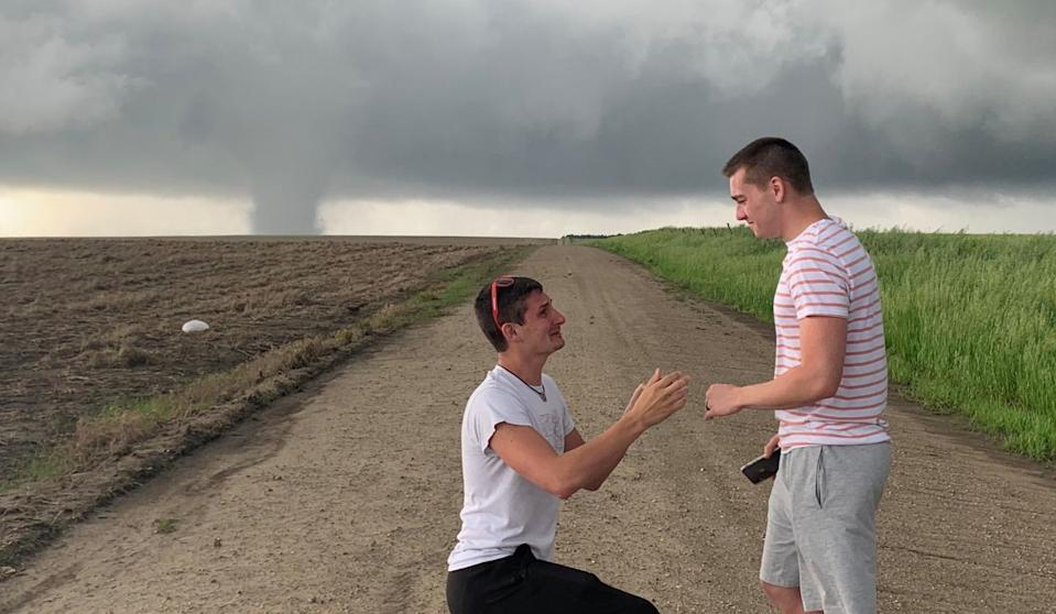 Storm chaser Joey Krastel proposes to his boyfriend as a twister rages in the background. (Photo: Twitter)