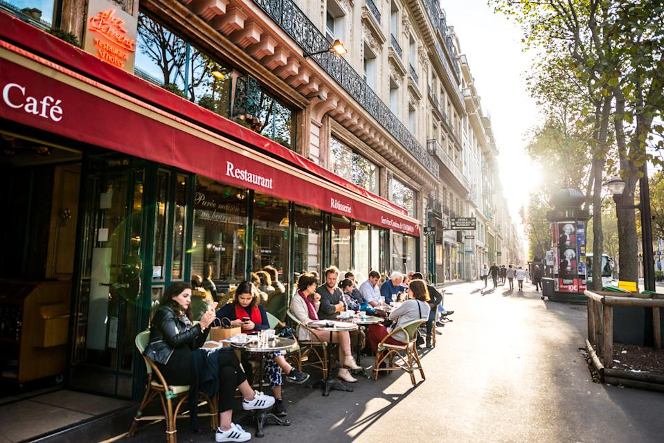 Paris, France - September 25, 2016: People relaxing, eating and drinking in restaurant in Paris