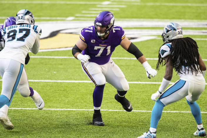File-This Nov. 29, 2020, file photo shows Minnesota Vikings offensive tackle Riley Reiff (71) in action in the third quarter of an NFL football game against the Carolina Panthers in Minneapolis. Cincinnati bolstered its offensive line, which was a glaring weakness in a 4-11-1 2020 season, with the signing of ex-Vikings Reiff as the team seeks better protection for quarterback Joe Burrow. (AP Photo/David Berding, File)