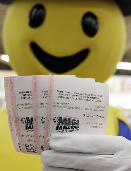 Mega Millions Lottery tickets that were given away to the first 540 people are displayed by the Hoosier Lottery's Mega Millions mascot at a store in Zionsville, Ind., Friday, March 30, 2012. The Mega Millions Lottery jackpot has reached a record $540 million.(AP Photo/Michael Conroy)