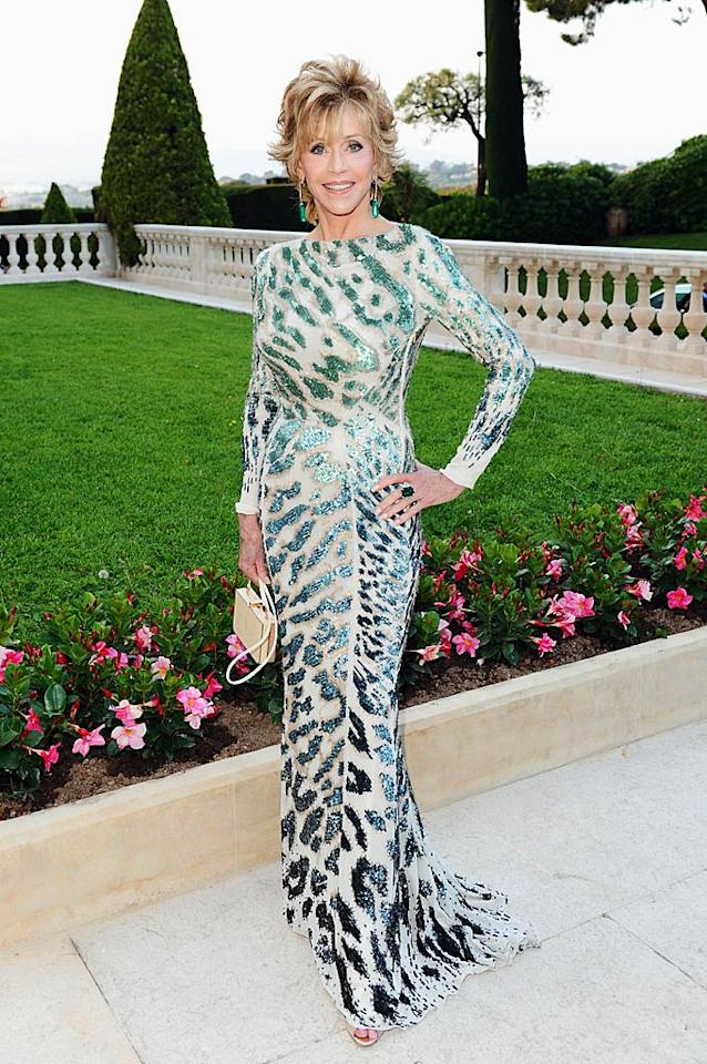 "73-year-old Jane Fonda put women a third of her age to shame at amfAR's annual Cinema Against AIDS Gala as she strutted through the soiree in a bedazzled Roberto Cavalli creation, emerald Chopard earrings, and nude peep-toes. Ian Gavan/<a href=""http://www.gettyimages.com/"" target=""new"">GettyImages.com</a> - May 19, 2011"