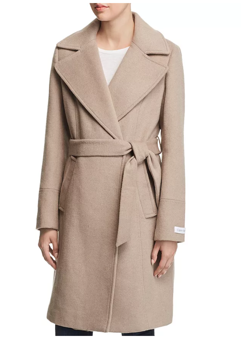"""<p><strong>Calvin Klein</strong></p><p>bloomingdales.com</p><p><strong>$194.60</strong></p><p><a href=""""https://go.redirectingat.com?id=74968X1596630&url=https%3A%2F%2Fwww.bloomingdales.com%2Fshop%2Fproduct%2Fcalvin-klein-notched-collar-wrap-coat%3FID%3D3090879&sref=https%3A%2F%2Fwww.countryliving.com%2Flife%2Fentertainment%2Fg36701989%2Froyal-family-fashion-hacks-style-tricks%2F"""" rel=""""nofollow noopener"""" target=""""_blank"""" data-ylk=""""slk:shop now"""" class=""""link rapid-noclick-resp"""">shop now</a></p><p>This camel coat is a perfect substitute for Meghan's staple and will remain timeless. </p>"""