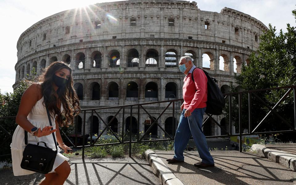 Italy has imposed a swathe of new restrictions to tackle a rise in Covid-19 cases - Guglielmo Mangiapane/Reuters