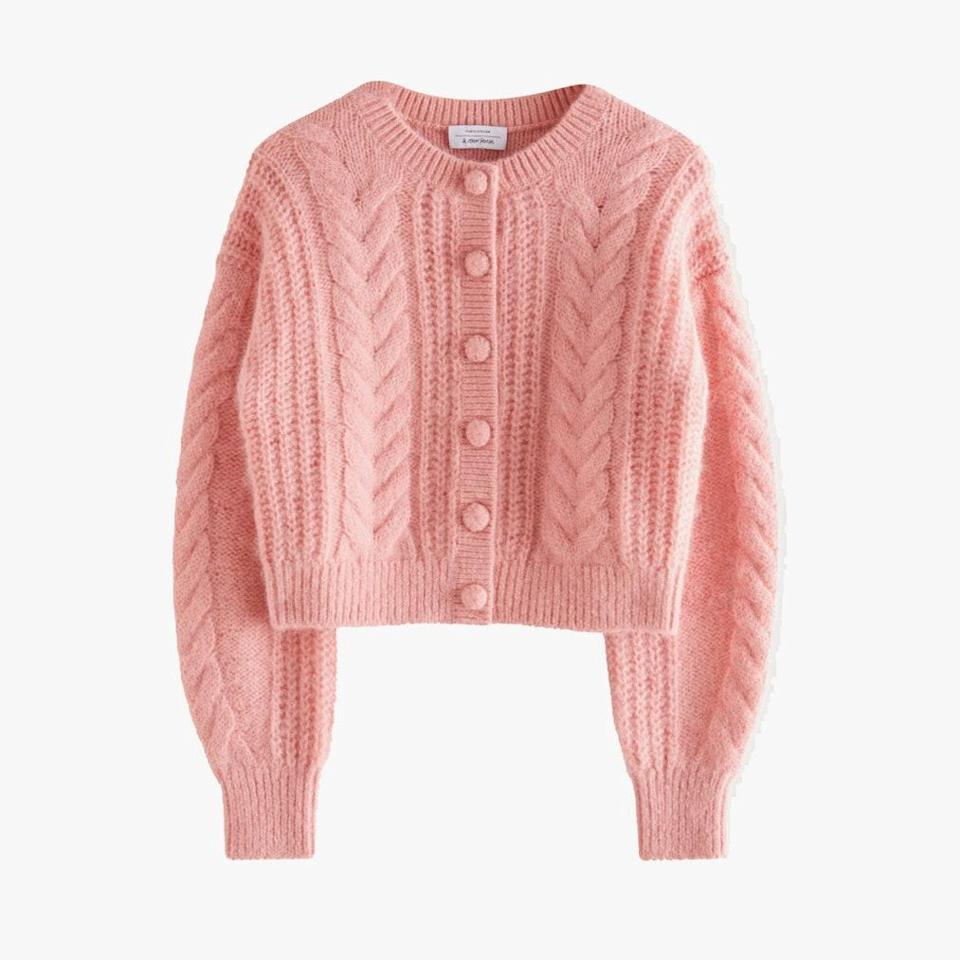 """$119, & OTHER STORIES. <a href=""""https://www.stories.com/en_usd/clothing/knitwear/cardigans/product.cropped-button-up-knit-sweater-pink.0901685001.html"""" rel=""""nofollow noopener"""" target=""""_blank"""" data-ylk=""""slk:Get it now!"""" class=""""link rapid-noclick-resp"""">Get it now!</a>"""