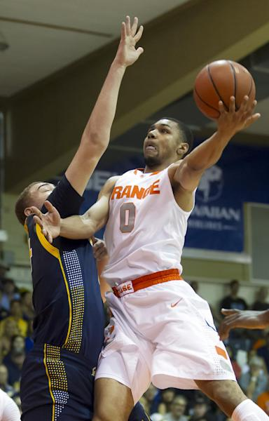 Syracuse forward Michael Gbinije (0) goes to the basket as California center Kameron Rooks (44) defneds during the first half of an NCAA college basketball game at the Maui Invitational on Tuesday, Nov. 26, 2013, in Lahaina, Hawaii. (AP Photo/Eugene Tanner)