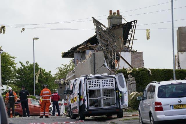 The blast destroyed three houses