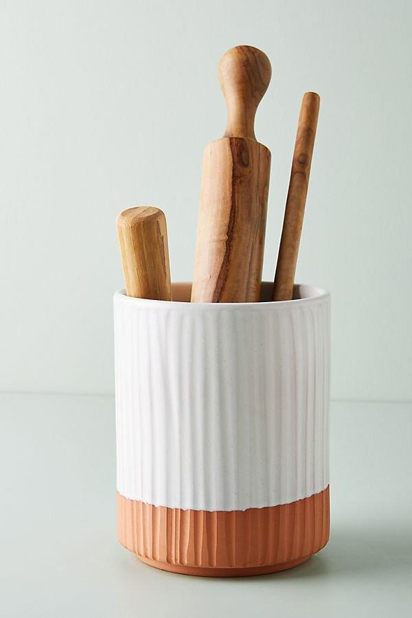 "<p>This terracotta utensil holder not only keeps your spoons and spatulas where they're easy to grab, but its color-blocked design ups the style quotient in your kitchen. </p> <p><b>To buy: </b>$32, <a href=""https://click.linksynergy.com/deeplink?id=93xLBvPhAeE&mid=39789&murl=https%3A%2F%2Fwww.anthropologie.com%2Fshop%2Fcolori-utensil-jar&u1=RS%2CAnthropologieJustLaunchedMoreThan1%252C700NewHomeItems%25E2%2580%2594Our5FavoritesUnder%252450%2Ckholdefehr1271%2CDEC%2CIMA%2C691325%2C202001%2CI"" target=""_blank"">anthropologie.com</a>. </p>"