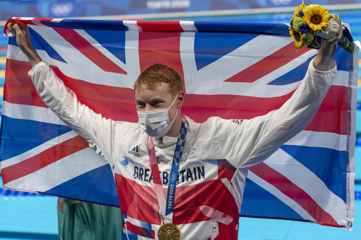 Tom Dean of Great Britain celebrates with the gold medal and the Union Jack flag after winning the men 200-meter freestyle final during the Tokyo 2020 Olympic Games on July 27, 2021. / Credit: Giorgio Scala / Orange Pictures / Getty Images