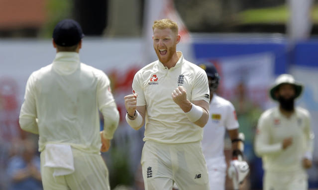 England's Ben Stokes, center, celebrates taking the wicket of Sri Lanka's Dhananjaya de Silva during the fourth day of the first test cricket match between Sri Lanka and England in Galle, Sri Lanka, Friday, Nov. 9, 2018. (AP Photo/Eranga Jayawardena)