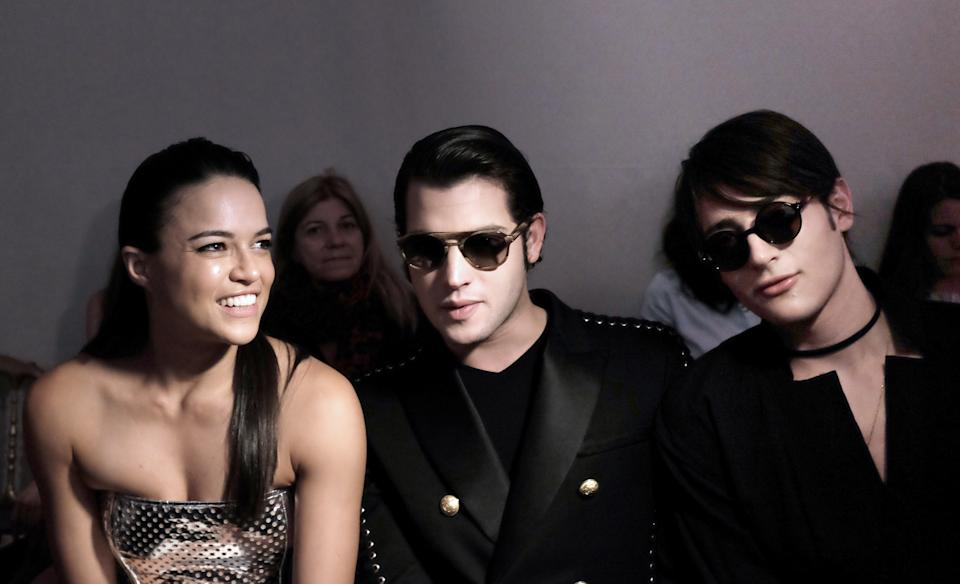 (L-R) US actress Michelle Rodriguez, US socialites Harry and Peter Brant pose during Jean Paul Gaultier 2015-2016 fall/winter Haute Couture collection fashion show on July 8, 2015 in Paris. AFP PHOTO / MIGUEL MEDINA (Photo credit should read MIGUEL MEDINA/AFP via Getty Images)
