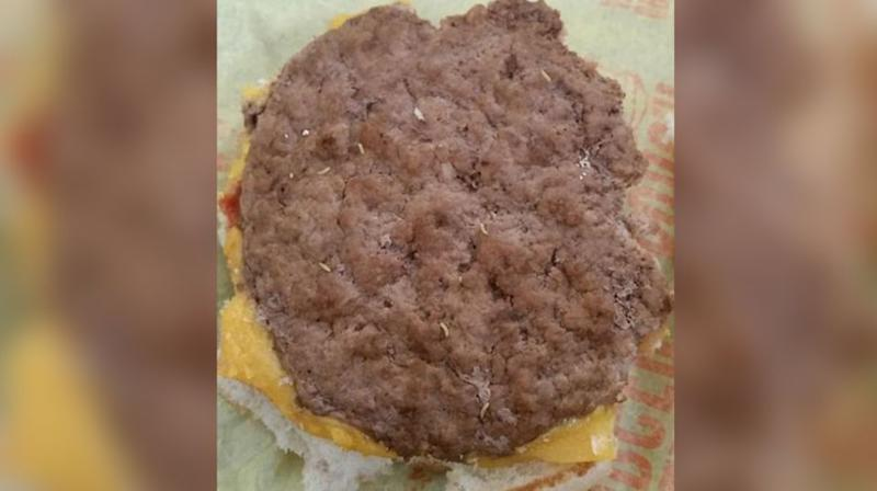 Emmi McHugh's three-year-old son had already tucked into his Happy Meal burger when she discovered something that wasn't listed on the menu. Source: Facebook