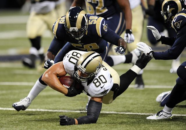 New Orleans Saints tight end Jimmy Graham (80) is brought down by St. Louis Rams outside linebacker Jo-Lonn Dunbar (58) after Graham gained 8 yards on a pass play in the first quarter of a preseason NFL football game Friday, Aug. 8, 2014, in St. Louis. (AP Photo/L.G. Patterson)