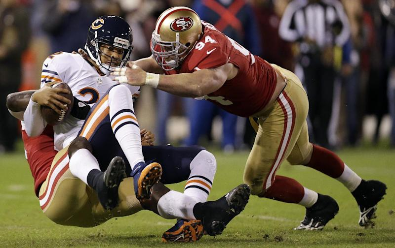 Chicago Bears quarterback Jason Campbell (2) is sacked by San Francisco 49ers linebacker Aldon Smith, left, as defensive tackle Justin Smith (94) converges during the first quarter of an NFL football game in San Francisco, Monday, Nov. 19, 2012. (AP Photo/Marcio Jose Sanchez)